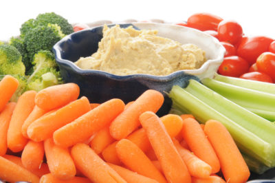 close-up of vegetables and hummus