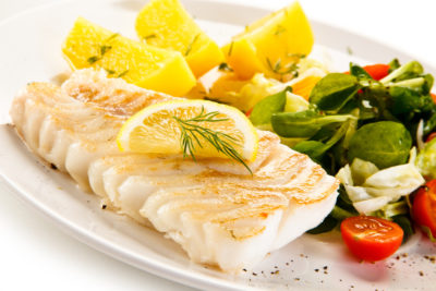 White fish fillet and vegetable dish