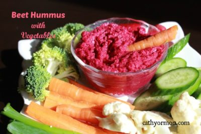 Dish of Beet Hummus with fresh vegetables