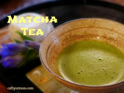 a frothy bowl of bright green matcha tea