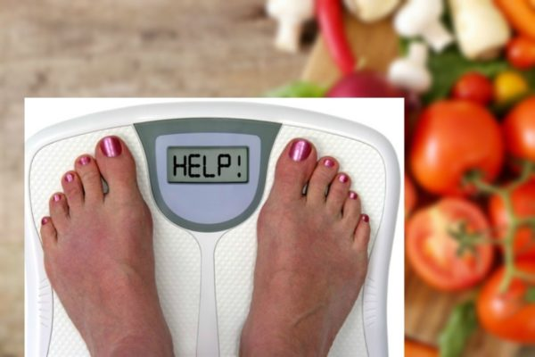 person's feet on weigh scale with the word HELP displaying